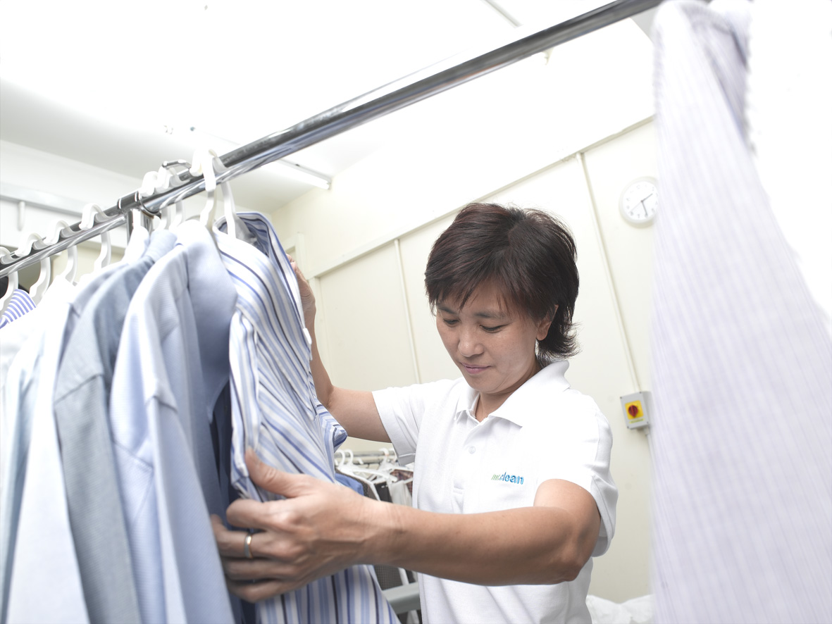 mr clean staff is checking the laundry condition